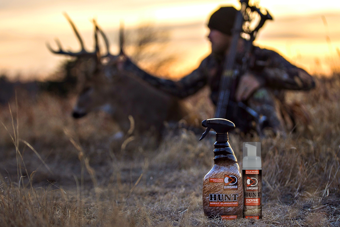 elimishield hunt scent elimination spray and core body foam in foreground, hunter with buck in background
